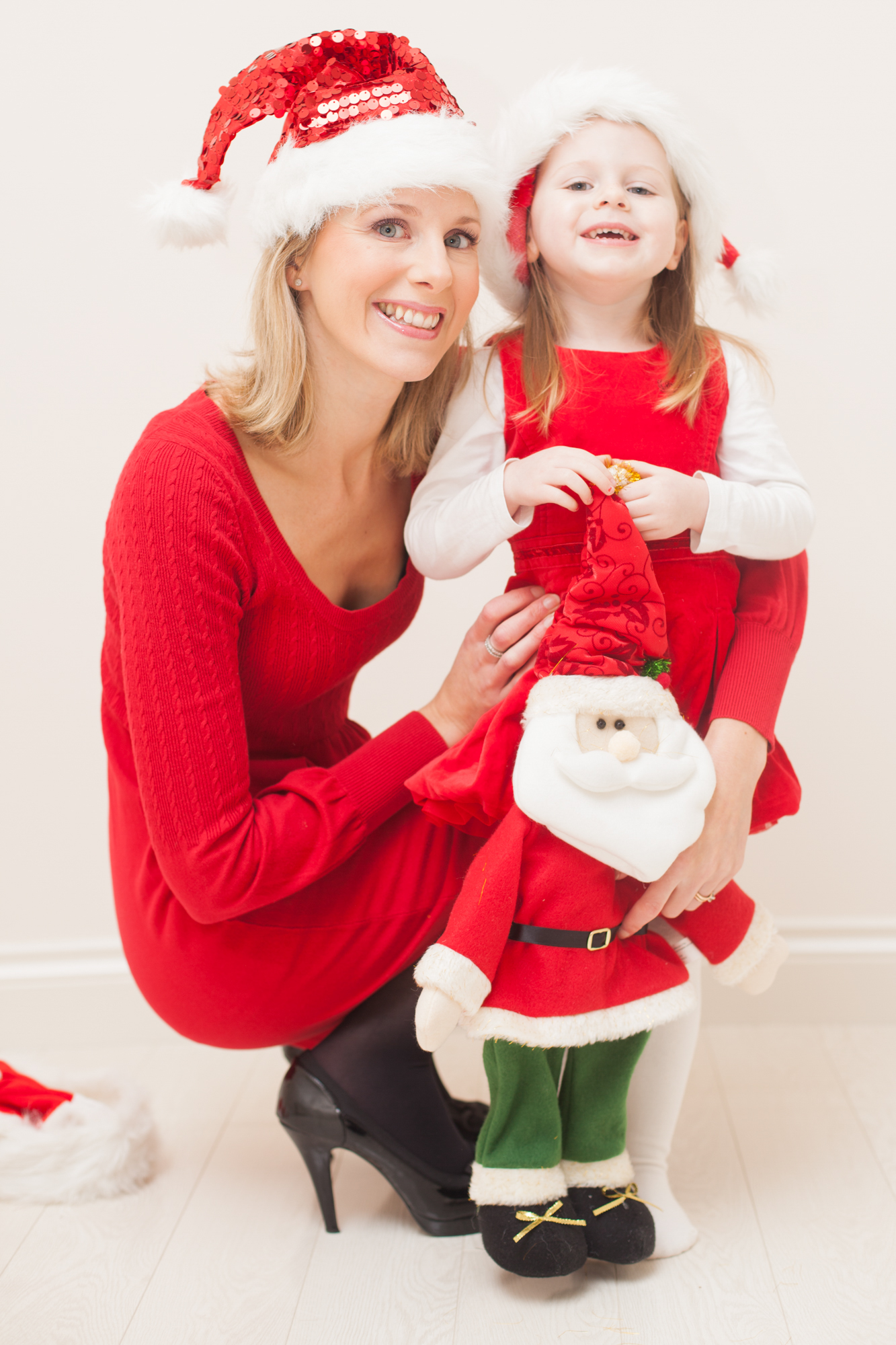 Mum-in-Residence Laura Haugh is pictured with daughter Lucy (3) who is giving her soother to Santa Claus this Christmas